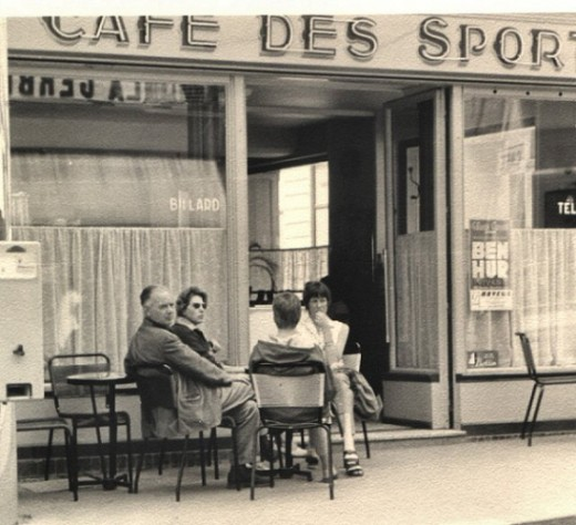 On vacation in France in the late 1950s enjoying a café au lait or a red wine.