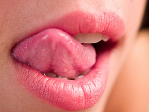 Licking your lips may seem like a quick way to get rid of the dryness but it actually dries your lips even more. Our acidic saliva can also cause redness and small wounds. Using lip balm is a much better idea.