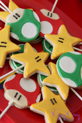 Star and mushroom cookies on sticks.