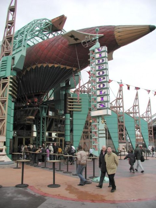 Cafè Hyperion & Vidopolis Theatre at Disneyland Paris.  The entrance is beautifully themed with a big Jules Verne style zeppelin