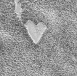 A heart-shaped impression seen on the surface of Mars.  From Wikimedia Commons.