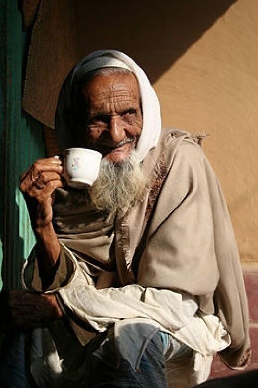 Bangladeshi man drinking tea.  Photo shared on Flickr by synthia k