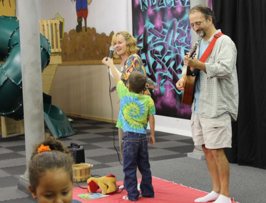 Tami's son participated by holding the microphone.  You can see Mac, the yellow and red toy dog, on the floor, taking it easy!