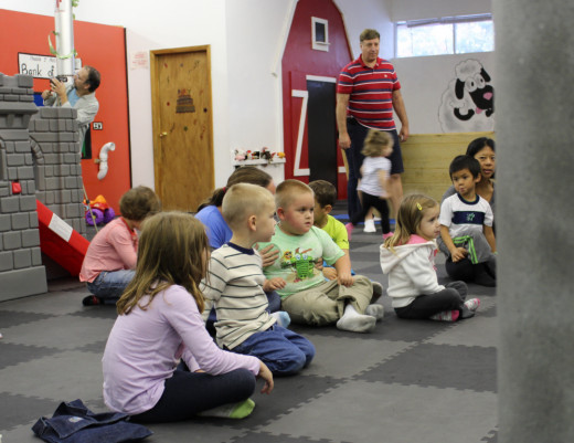 My nephew Logan and other kids at Kidz Club in Phoenix, New York, patiently waiting to hear about Mac the Dog.
