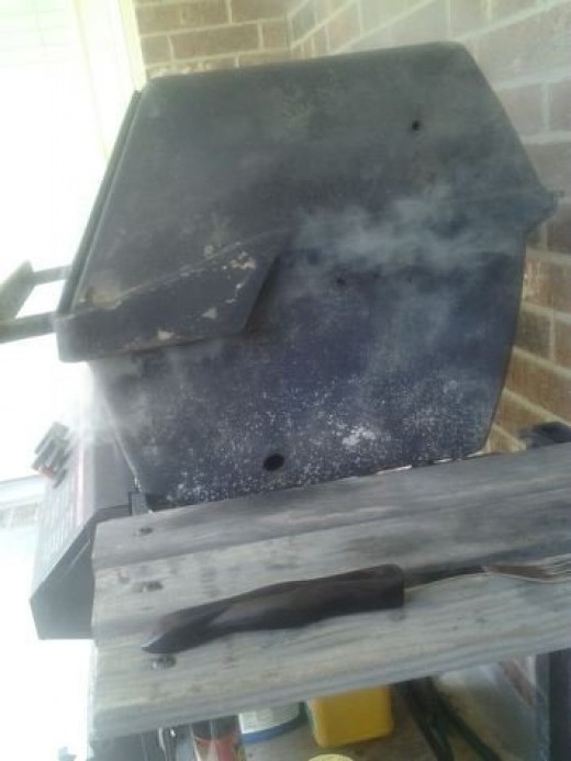 The old BBQ smoking away while grilling one side of our Fajita Steak
