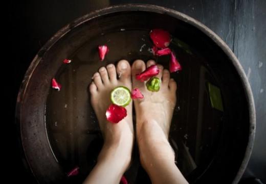 Woman Soaking Feet at a Spa