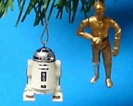 R2D2 & 3CPO Are The Droids From Star Wars.  The image is from Amazon and the droid ornaments are sold here.