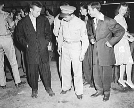 Check out these ZOOTSUITS!  Very big, very cool.  These cool cat costumes would look great when paired alongside your ladies 1940s dresses.  This picture is from Wikipedia and is in the public domain.
