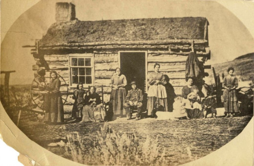 An early polygamous family, photographed by Charles Roscoe Savage.