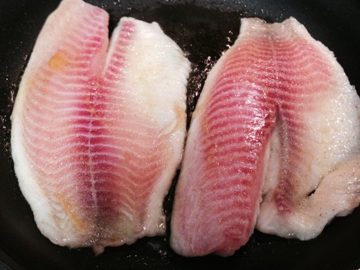 Tilapia at the beginning of the cooking process