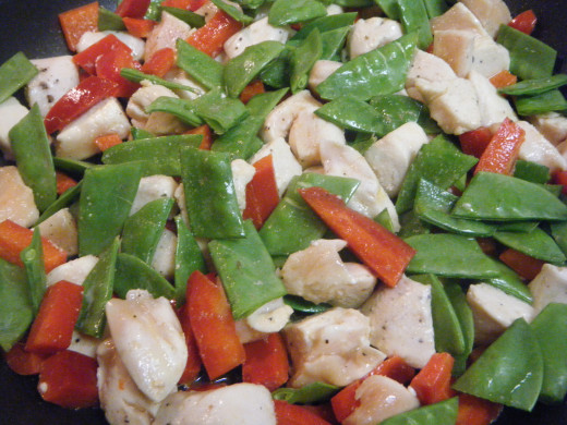 Chicken, snow peas, and red bell peppers.