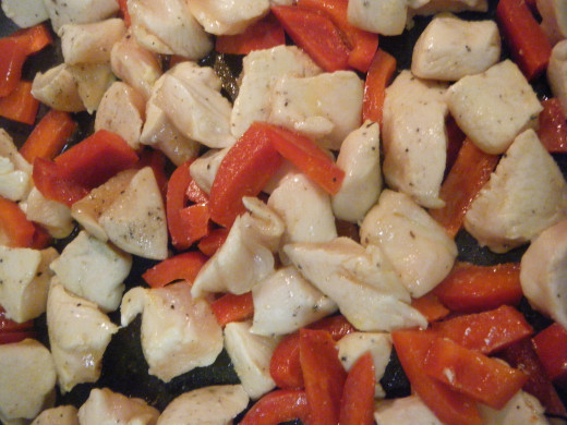 Sauteeing the chicken and red bell pepper.