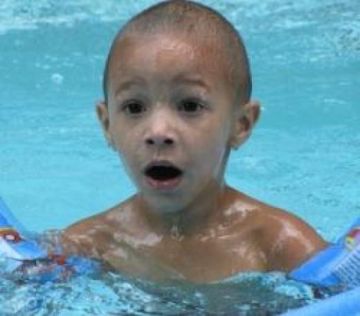 Surprised Kid in Pool