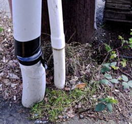 old duct tape joins 2 white pipes