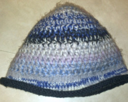 crocheted multicolor wool beanie with knitted rolled cuff trim made in my youth. Similar to black beanie on page 102