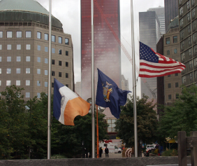 Flags are flown at half mast for the firefighters, policeman and rescue workers lost during the 9/11 attacks