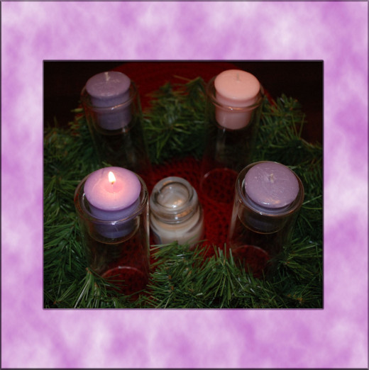 The Second Sunday of Advent, a second purple candle is lit.  This is often done by the oldest child of the household.  First, light the candle from the previous week and repeat the prayer of that week.  Then, light a second purple candle.  The head o