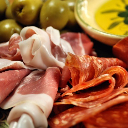 Prosciutto and a selection of salami.