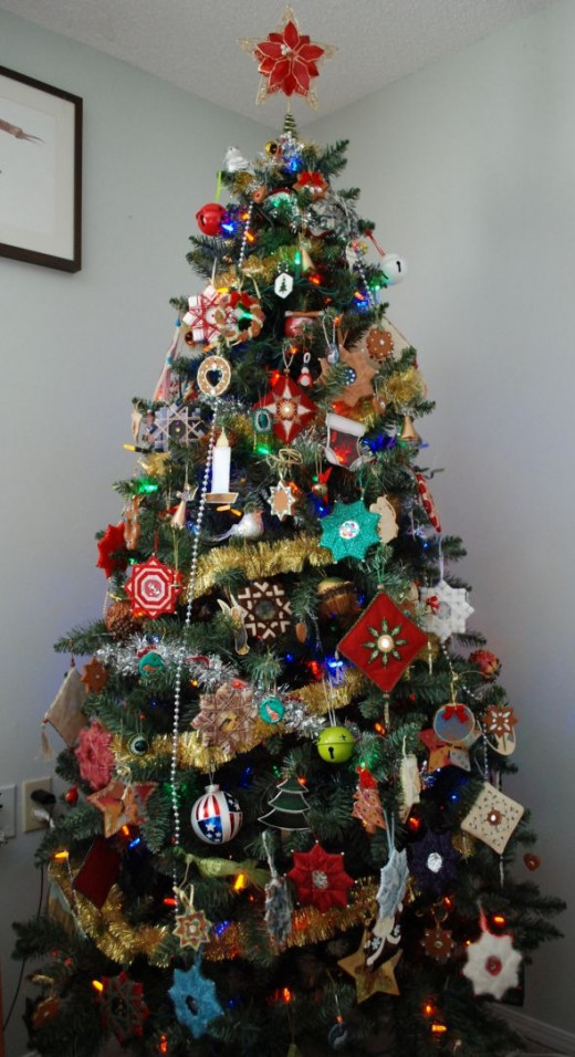 My daughters decorated our tree for 2012, stuffing on as many decorations as they could.  We've long since run out of room to hang all of them on the tree!  Near the top of the tree are some small stamped medallions with wolf and eagle motifs, made a