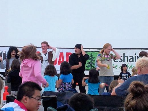 Participants enjoying the festical spirit, including dancing the Macarena.