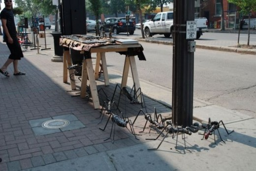 Metal insects at a Whyte Ave intersection