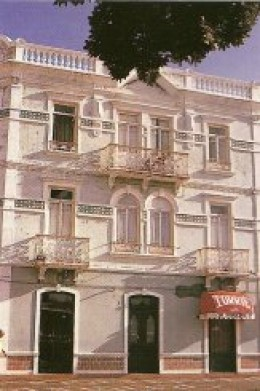 Delicate iron lace balconies add a Mediterranean look to the buildings.