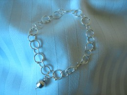I love simple statements and for me, the bracelet fashioned above is stunning in it's simplicity. It looks clean, fresh.