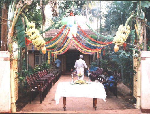 "Entrance to the venue of a wedding in Jaffna. Note the Plantain plants and ""full Pot"" with traditional lamps."