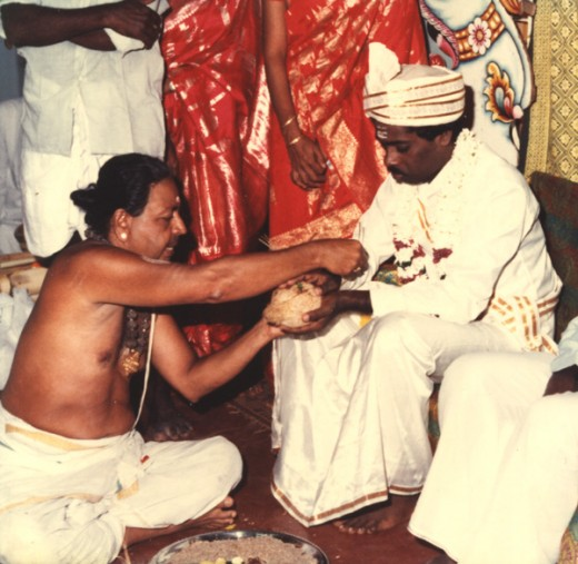 Hindu priest officiating the wedding ceremony