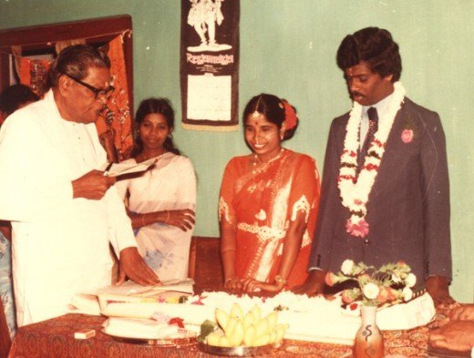 During the legal registration ceremony. Note the groom is seen in western dress.