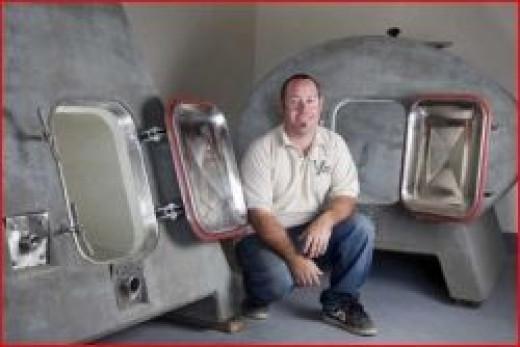 Micah Utter with Concrete Fermentation Tanks
