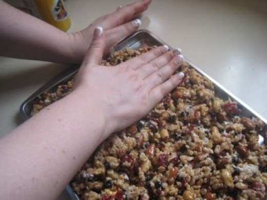 Trail Mix bars being pressed into pan