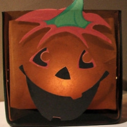 Easy Halloween Craft: A Jack-o-lantern Candle that will add a Glow!