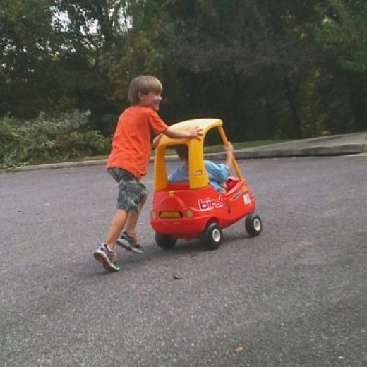 6 year old pushing a 4 year old brother in the Coupe outdoors--what FUN!