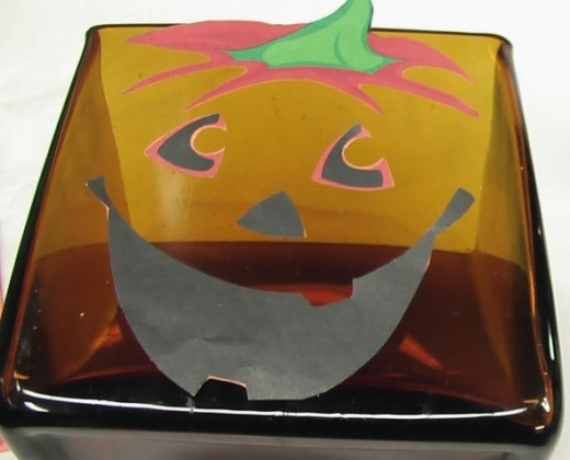 Lay out the Jack o lantern face on your  container