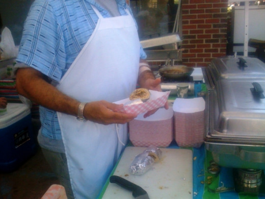 Begin with a Breakfast Burrito with homemade salsa from the Homewood Gourmet tent.