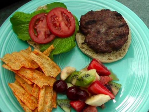 Finished burger with Sunchips and Fruit Salad! Dig In!