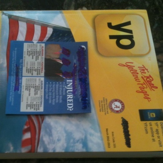 Phone book with a magnet advertizement on front. I usually trash those magnets.
