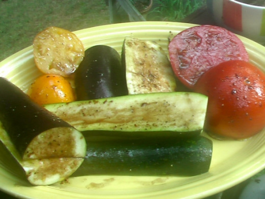 Eggplant, zucchini squash and tomatoes ready to go on the medium-hot grill.