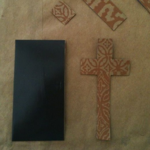 I cut the cross out. Still have another side to use. See the cut-out strips at the top of the photo?