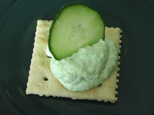 Benedictine on a cracker with a cucumber slice--yum!